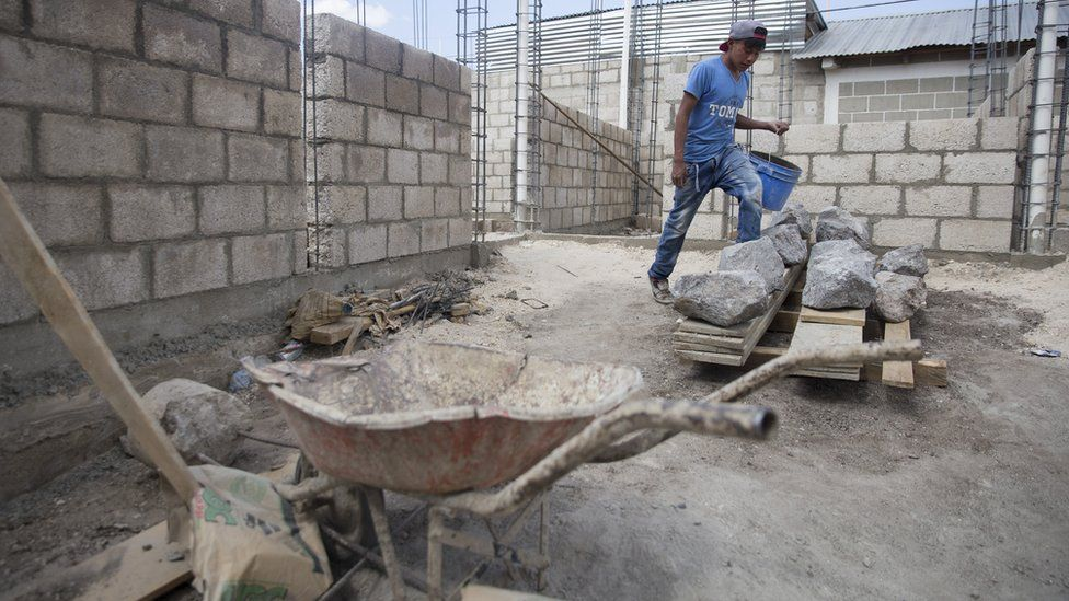 A man works on a construction site in Zunil
