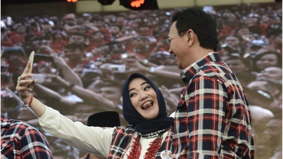 A supporter takes a selfie with Mr Purnama at his final campaign rally in Jakarta on 11 February 2017.
