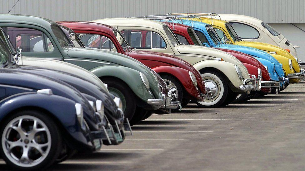 Volkswagen Beetles at an exhibition at a factory in Puebla, Mexico, where the last model came off the production line, August 2003