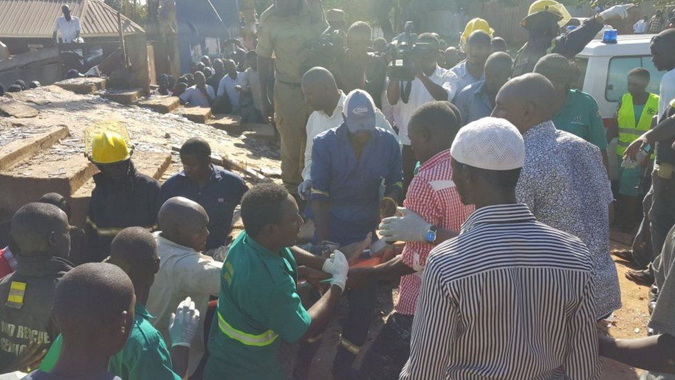 Person being rescued from building in Kampala