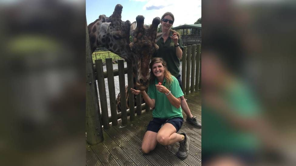 Folly Farm staff with a giraffe