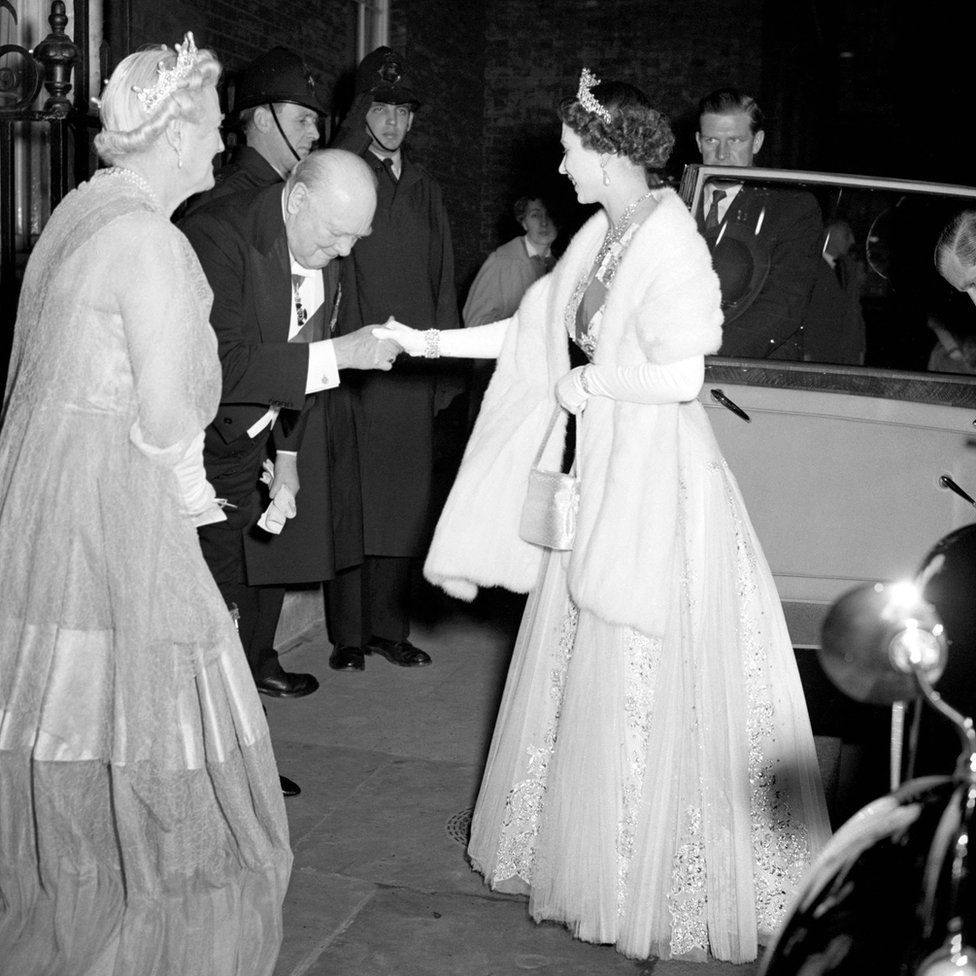 Prime Minister Sir Winston Churchill bowing to Queen Elizabeth II as he welcomes her and the Duke of Edinburgh to 10 Downing Street for dinner