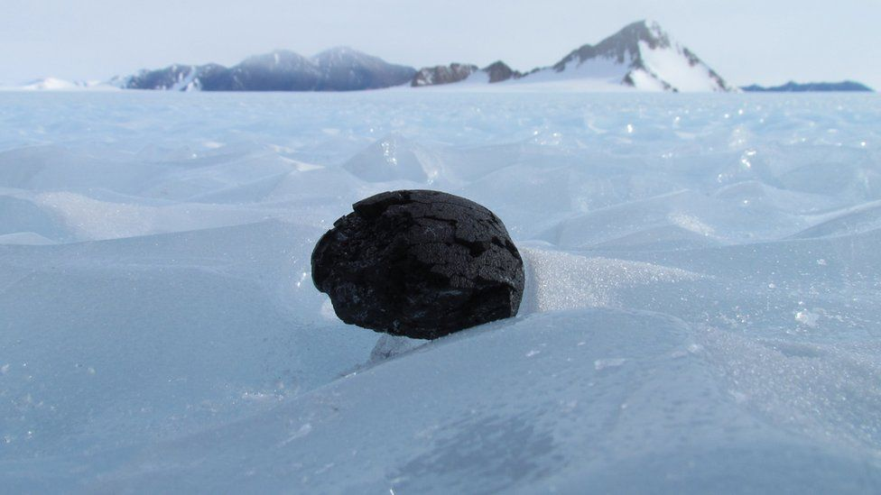 meteorite sitting on ice in Antarctica