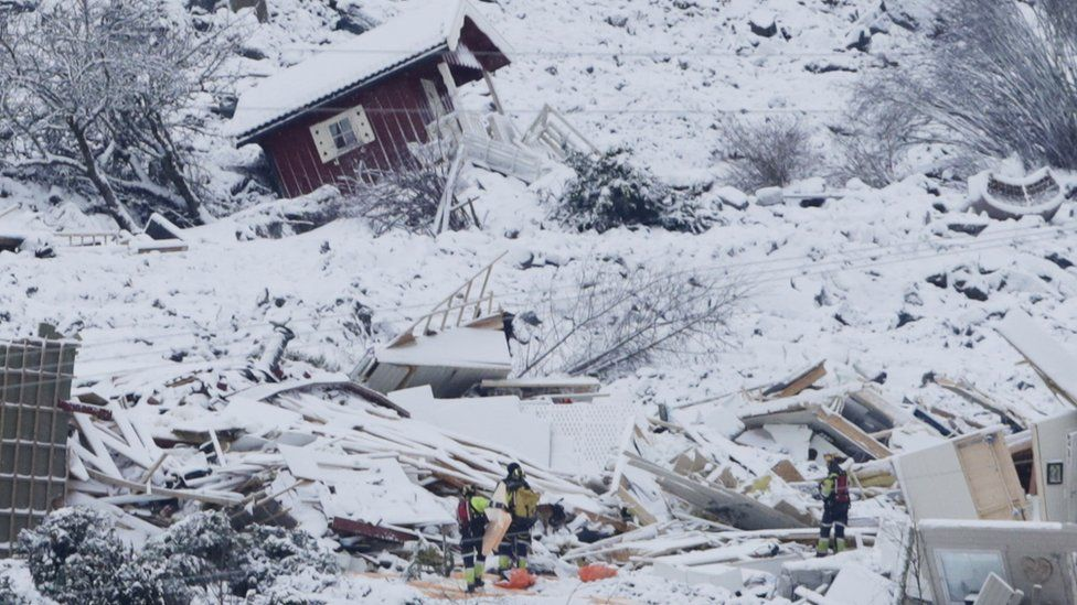 Rescue crews are working in the landslide area where a large landslide occurred at Ask in Gjerdrum municipality, Norway, 01 January 2021.