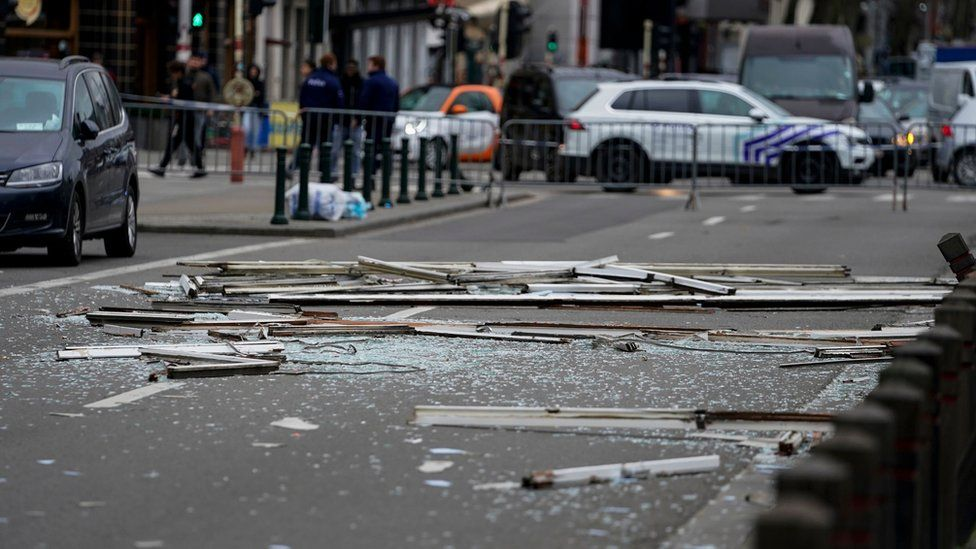 Debris is spread across a road near a partially collapsed building in Brussels, 9 February 2020