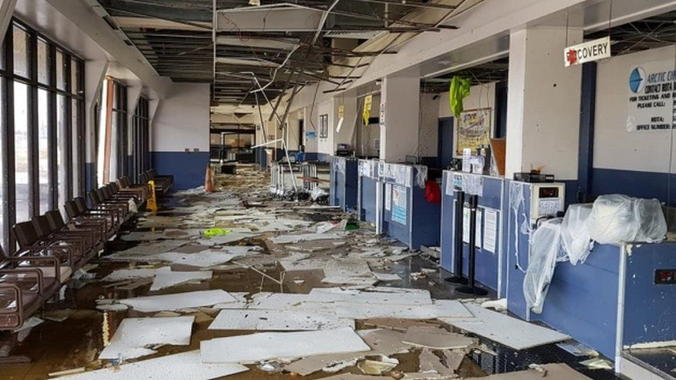 Debris is photograph scattered over airport counters and floor