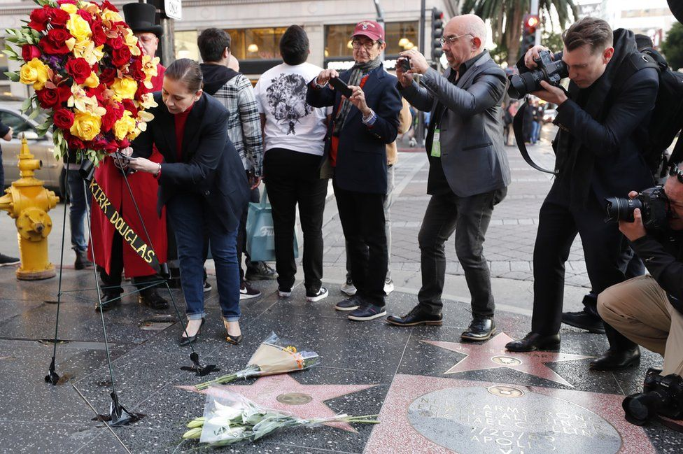 A floral tribute being erected at Douglas's star on the Hollywood Walk of Fame