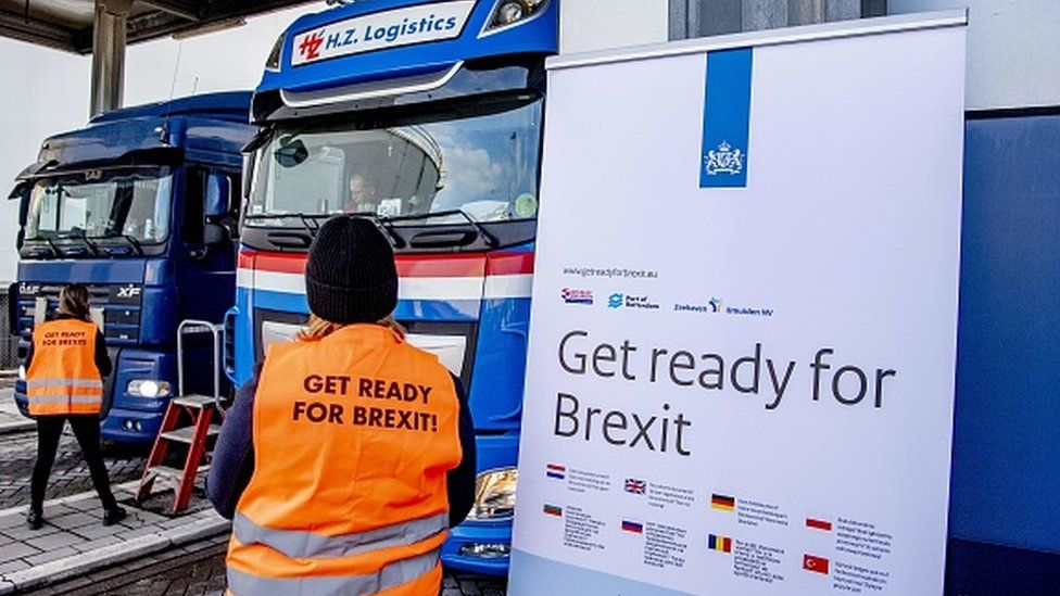 Flyers are distributed, as part of the Get Ready For Brexit campaign, to truck drivers at the terminal of a ferry operator in the port of Rotterdam