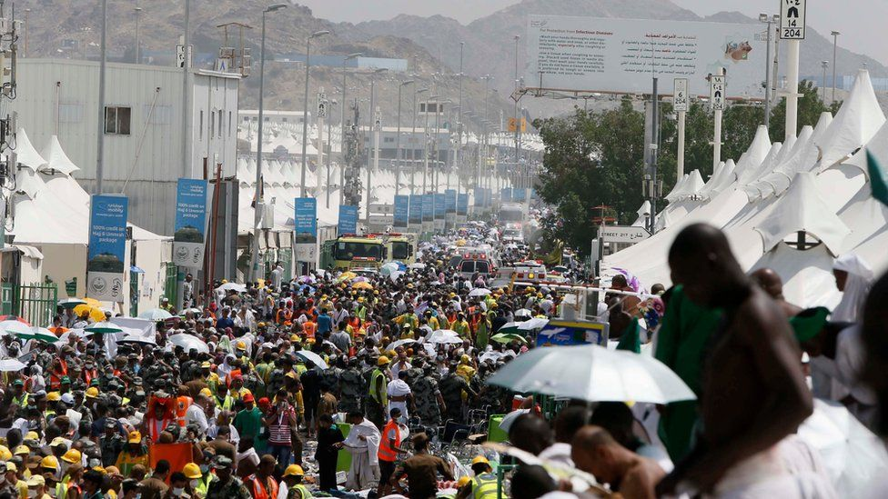 Muslim pilgrims and rescuers gather around the victims of a stampede in Mina, Saudi Arabia during the annual hajj pilgrimage on Thursday, Sept. 24, 2015.