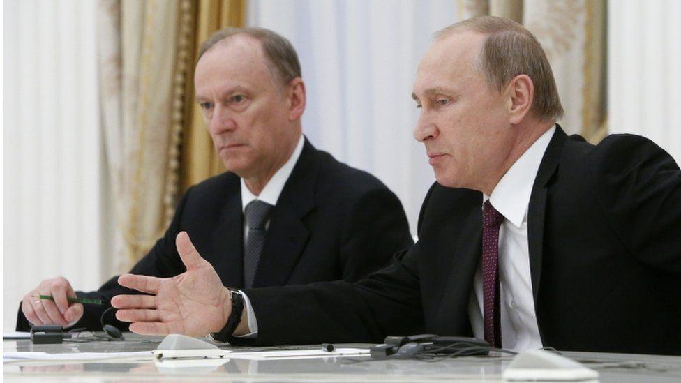 Russian President Vladimir Putin, right, accompanied by Security Council Secretary Nikolai Patrushev in 2015