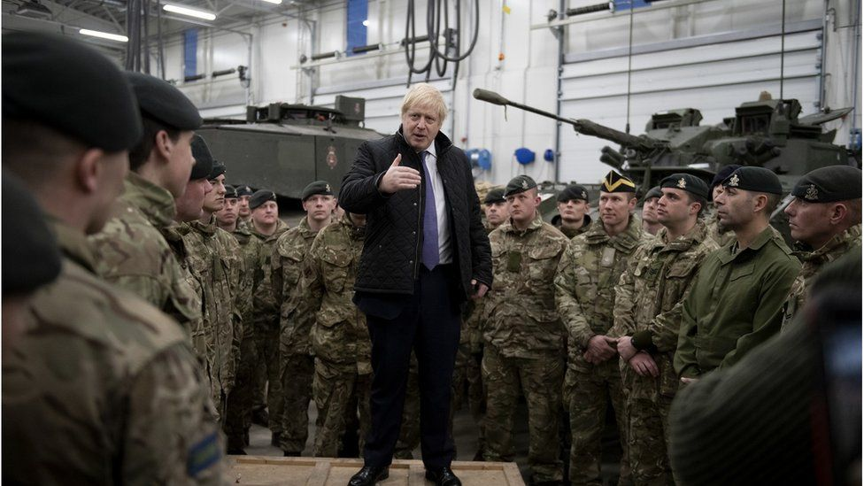 Boris Johnson spoke to British troops stationed in Estonia during a one-day visit to the Baltic country on 21 December.