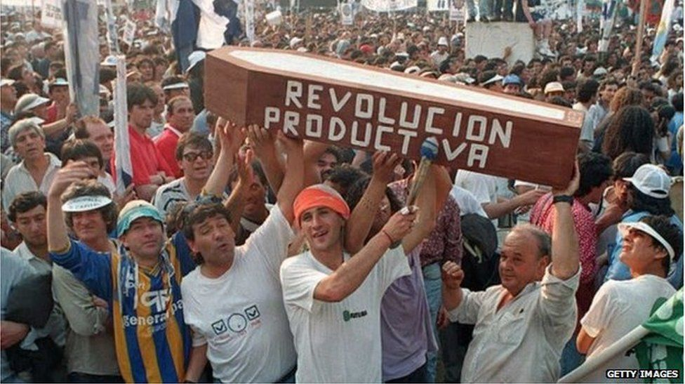 Demonstrators in Buenos Aries carrying a coffin as part of demonstration