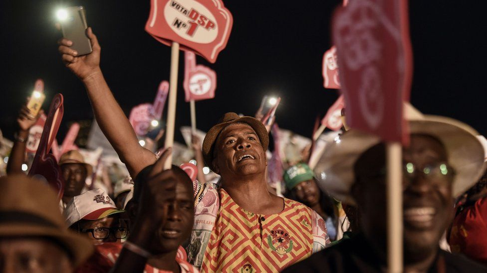 Supporters of presidential candidate Domingos Simoes Pereira (DSP) from the traditional ruling African Party for the Independence of Guinea-Bissau and Cape Verde (PAIGC) attend a rally at Nino Correa stadium in Bissau, on December 27, 2019, ahead of the December 29 poll. - Voters in Guinea-Bissau are being called out to cast their ballots in a presidential runoff on December 29, capping a year of turmoil in the poor, coup-prone West African state. After months of acrimony, people are being asked to choose between two former prime ministers - Domingos Simoes Pereira, from the traditional ruling PAIGC party, and opposition figure Umaro Sissoco Embalo.