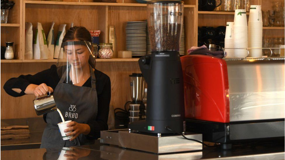 A woman working in a cafe