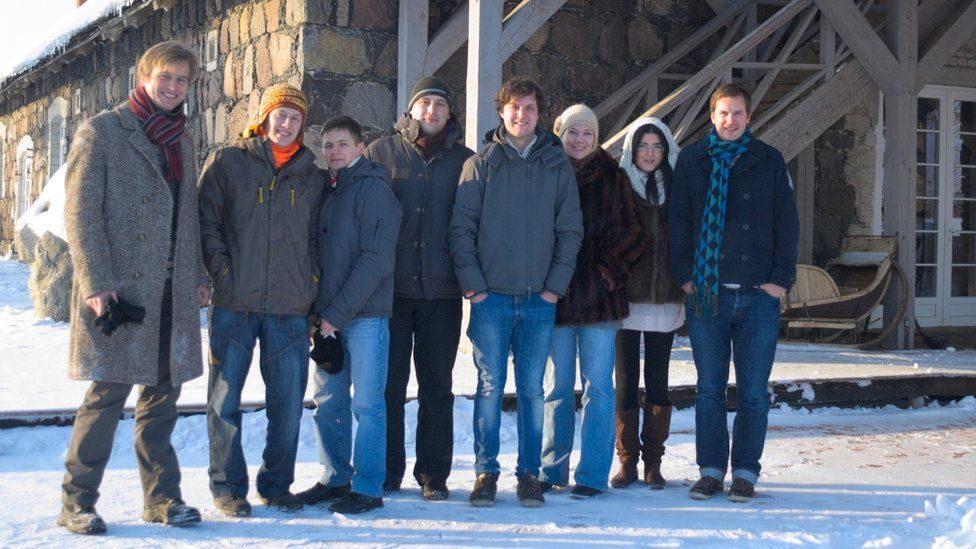 Eight TransferWise colleagues standing in the snow in 2011
