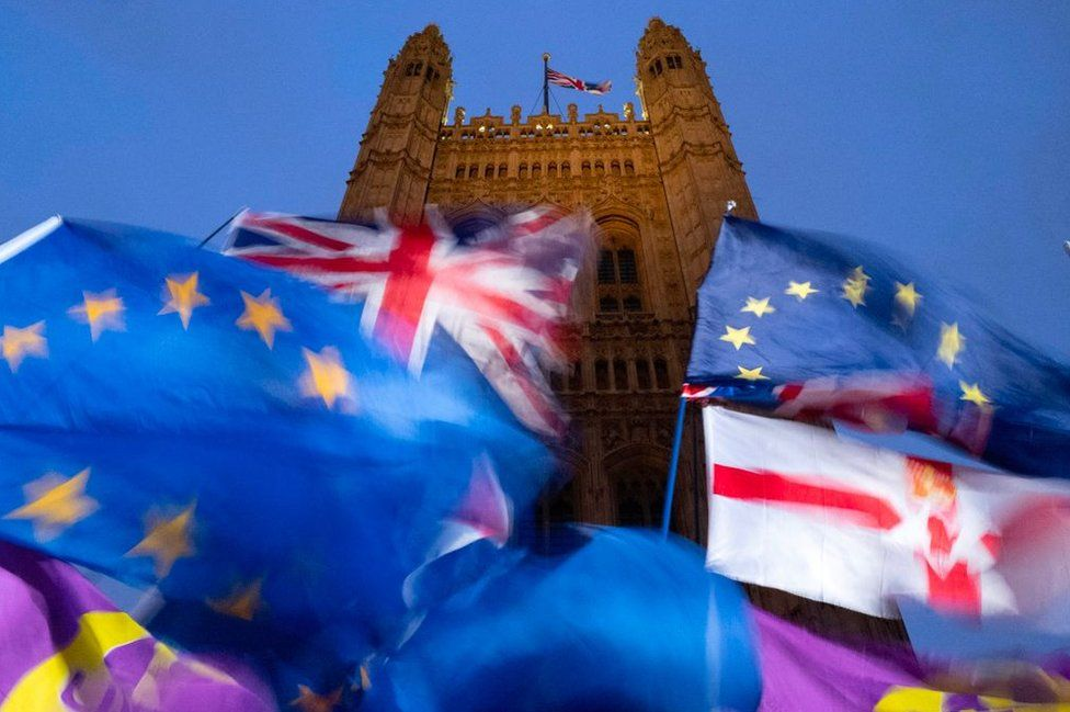 EU and union flags flying outside the Palace of Westminster