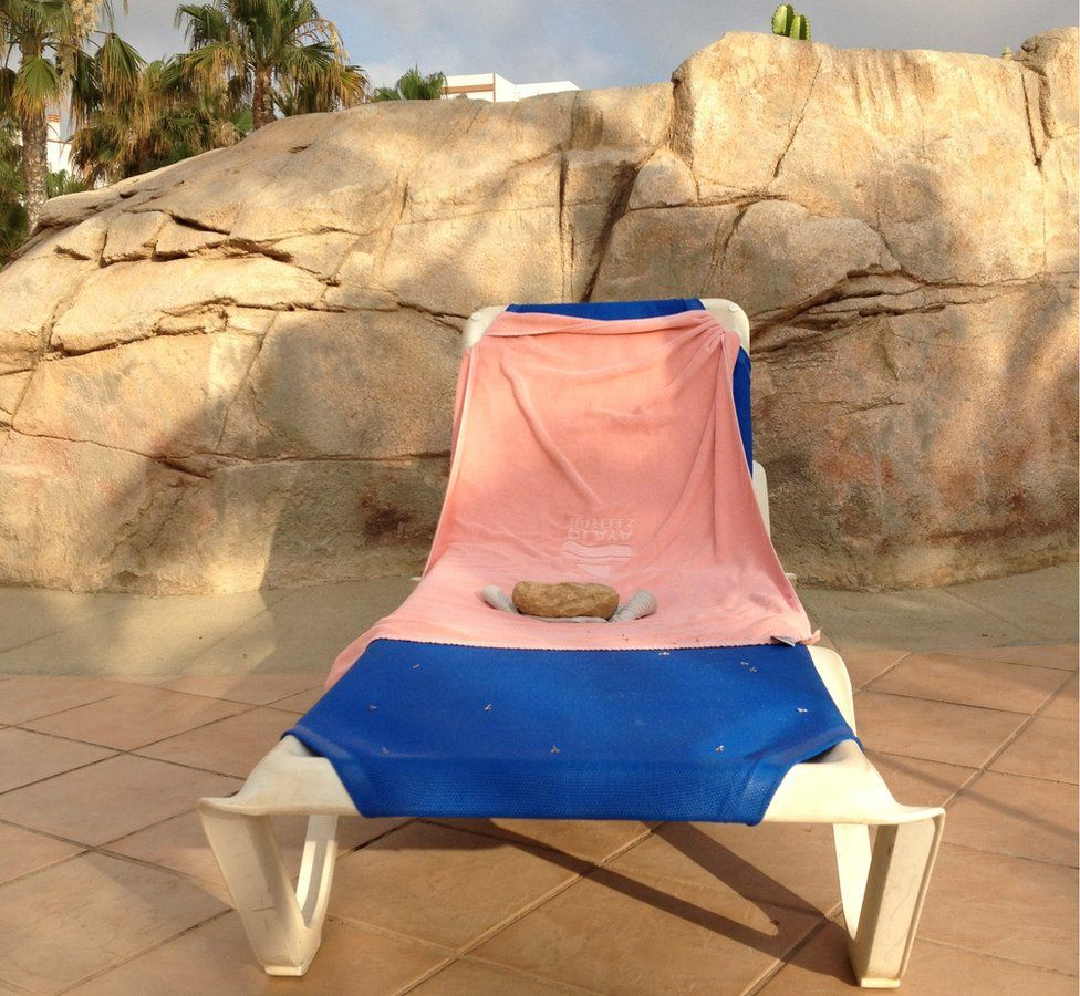 Sun lounger with a towel