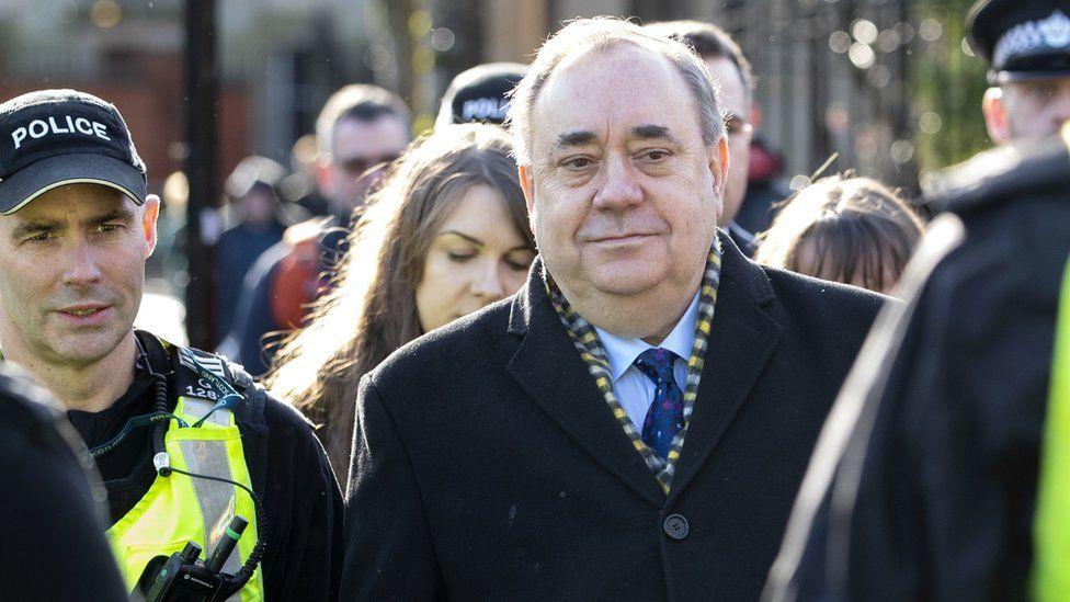 Alex Salmond accompanied by police