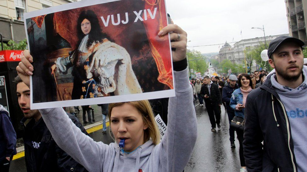 Protesters walk with Serbian flags and hold an image of the newly elected President of Serbia Aleksandar Vucic as Louis XIV, King of France in Belgrade, Serbia, 08 April 2017