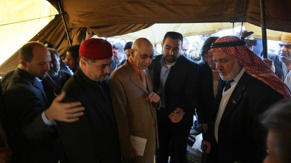 """Gerald Kaufman (3rd L), the head of a European Parliament delegation, meets with residents of Jabalia""""s Ezbet Abed Rabbo district"""