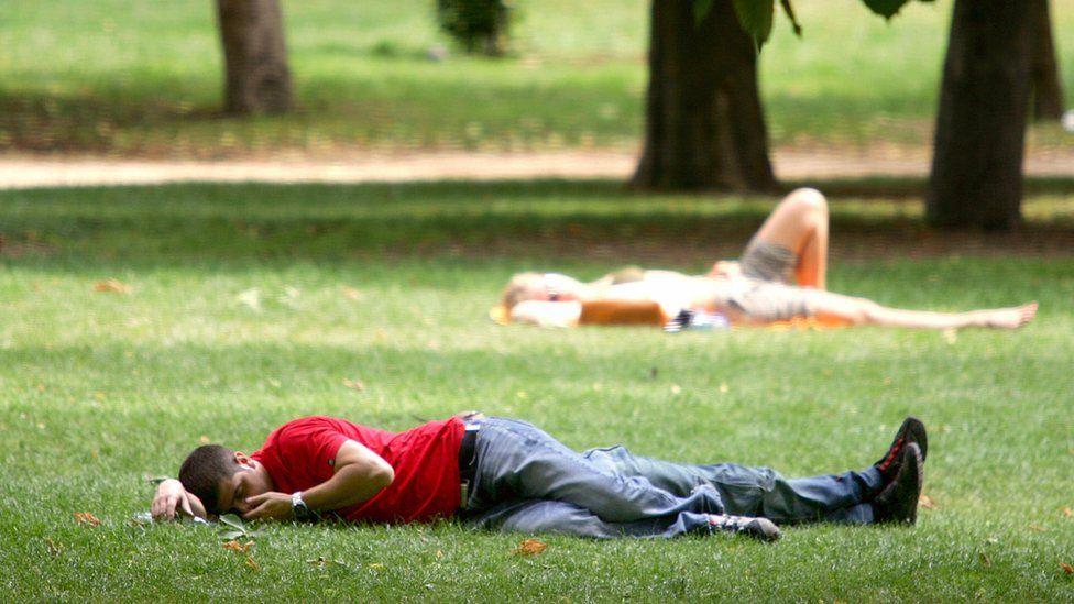 People have a siesta in the Retiro Garden, in Madrid 10 June 2005.
