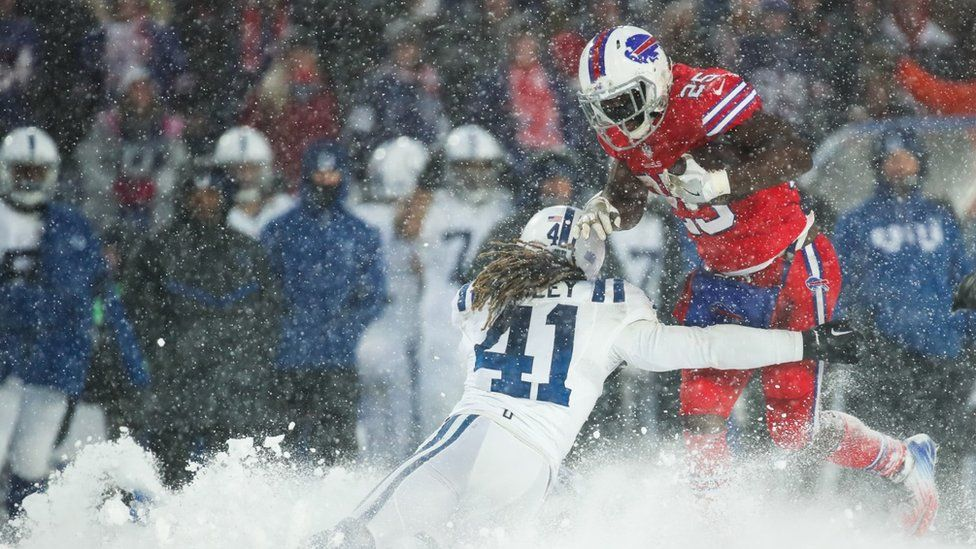 LeSean McCoy #25 of the Buffalo Bills runs the ball as Matthias Farley #41 of the Indianapolis Colts attempts to tackle him during overtime on December 10, 2017 at New Era Field in Orchard Park, New York.