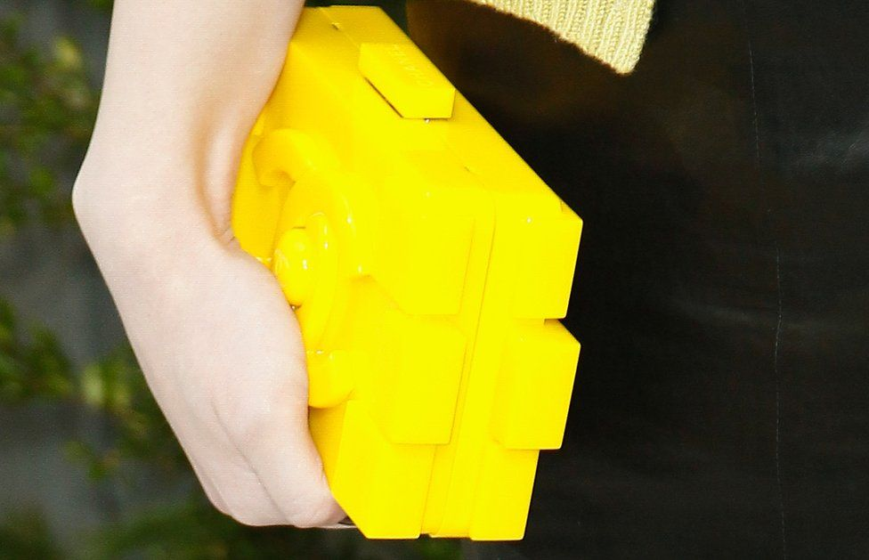 hand holding Chanel's Lego-inspired bag