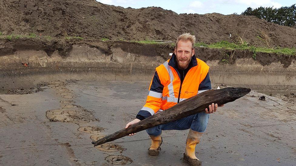 Dutch archaeologist Jeroen Loopik with a Roman oak pile, Katwijk, 2018