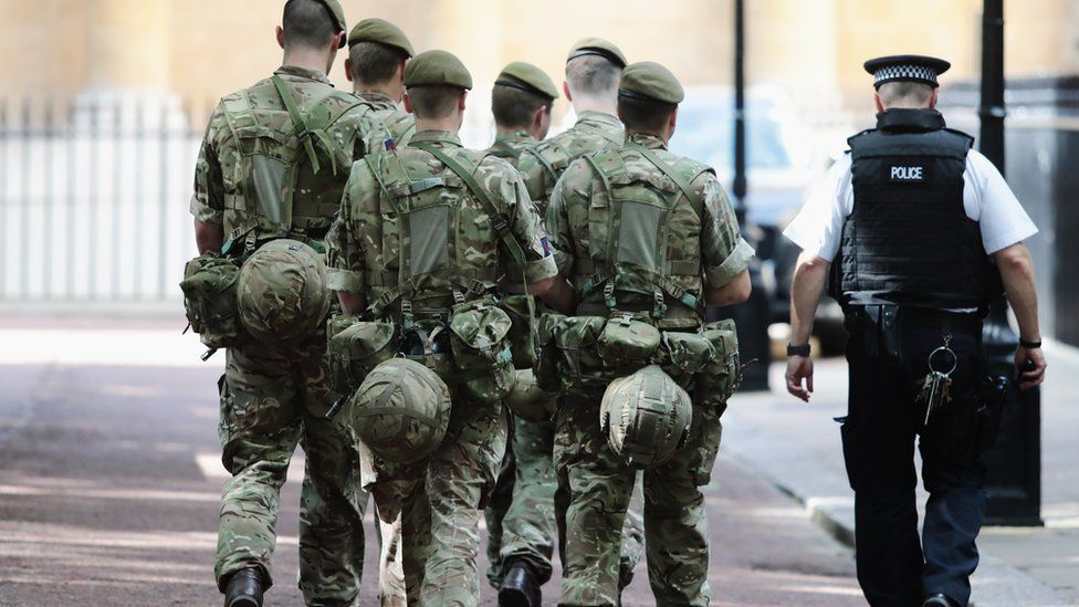 Soldiers arriving near Buckingham Palace in London in May 2017 as 984 military personnel are deployed around the country following the Manchester Arena Terror Attack