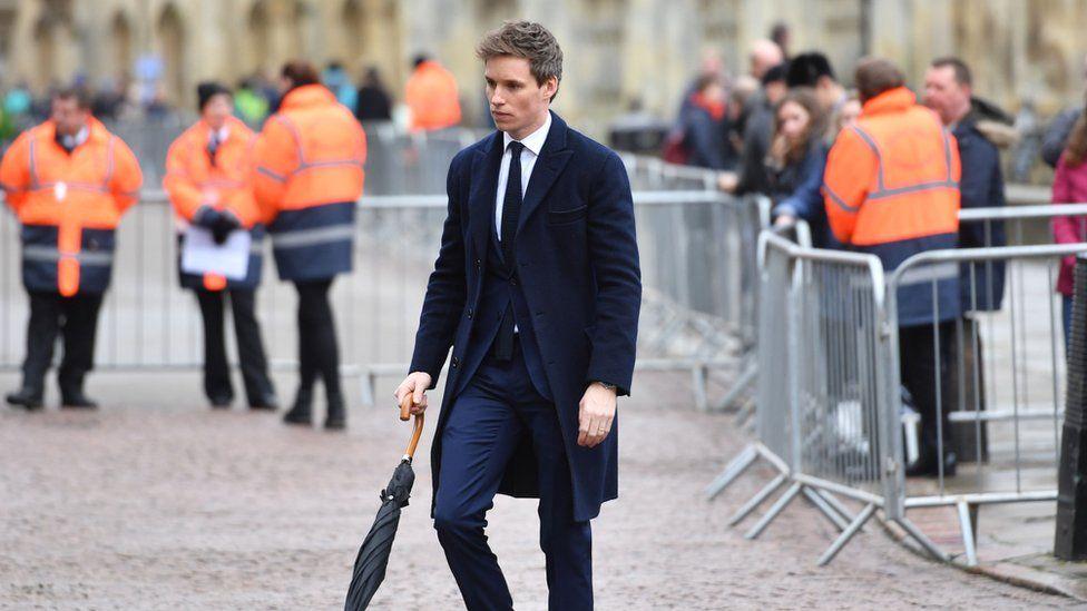 Eddie Redmayne arriving at funeral