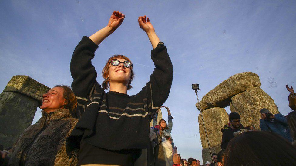 Woman celebrating at Stonehenge