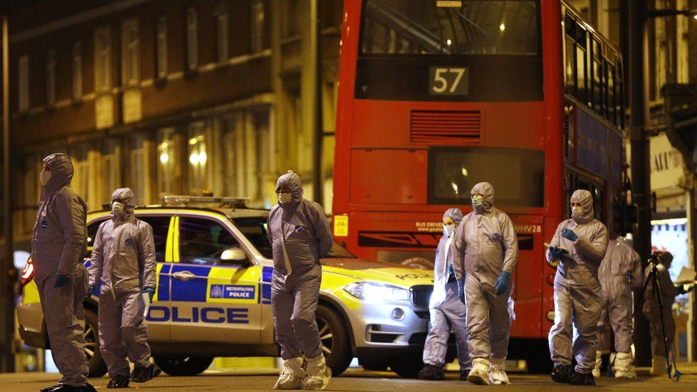 Forensic officers examine the scene where a man was shot and killed by armed police on February 2, 2020 in London, England