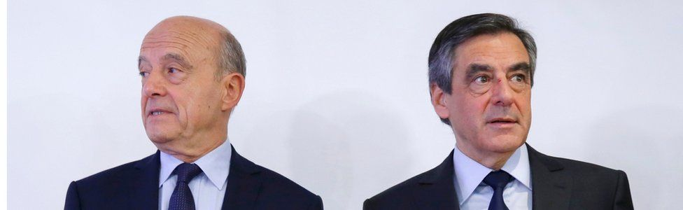 Alain Juppe (left) and Francois Fillon stand together in Paris after the primaries, 27 November
