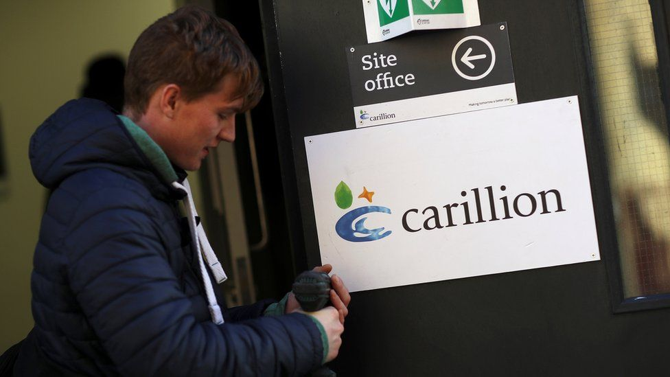 Carillion worker removes sign