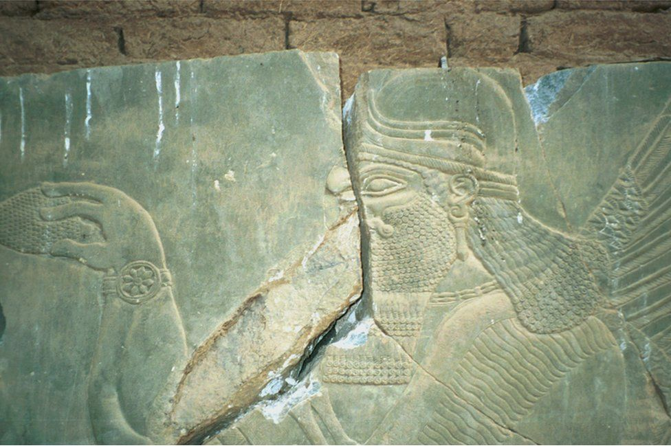 A relief split into parts by looters