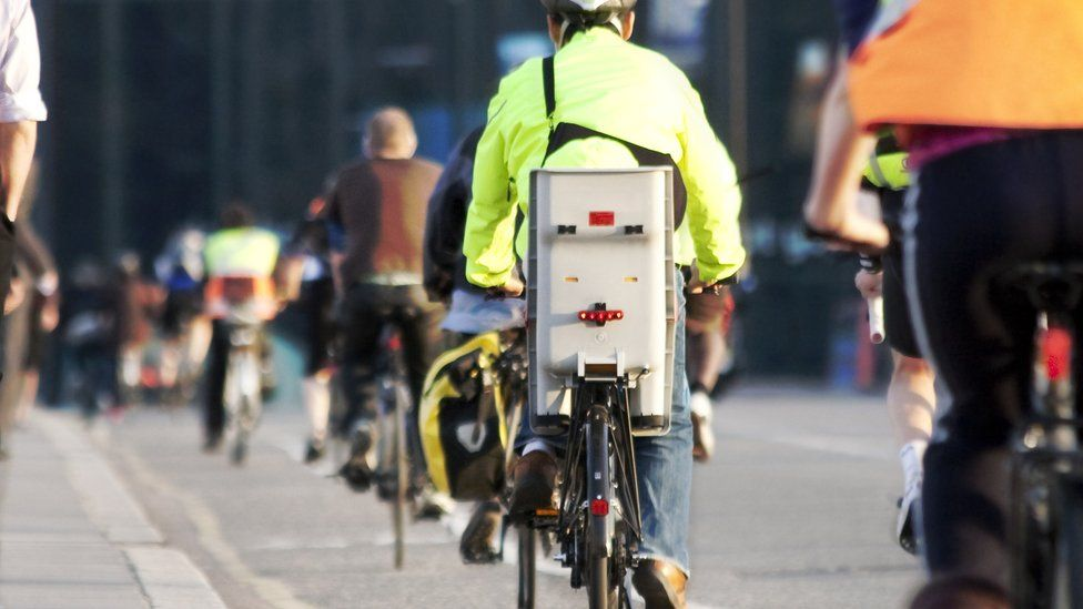 Cycling commuters on a busy road