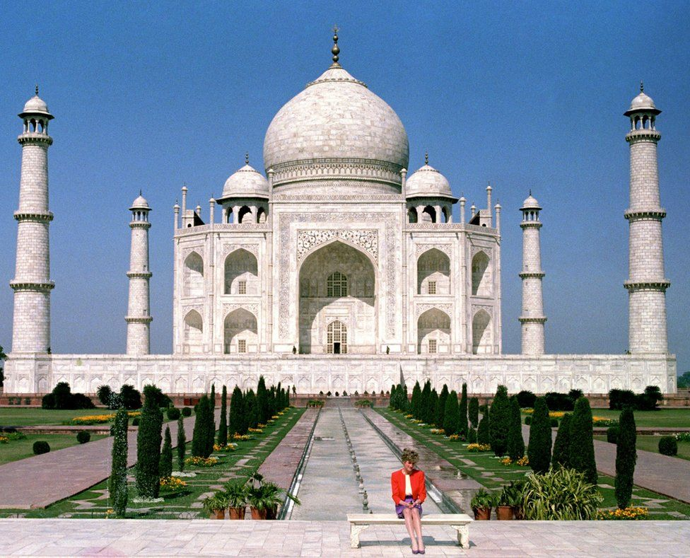 The Princess of Wales sits in front of the Taj Mahal alone, during a Royal tour of India on 11 Feb 1992