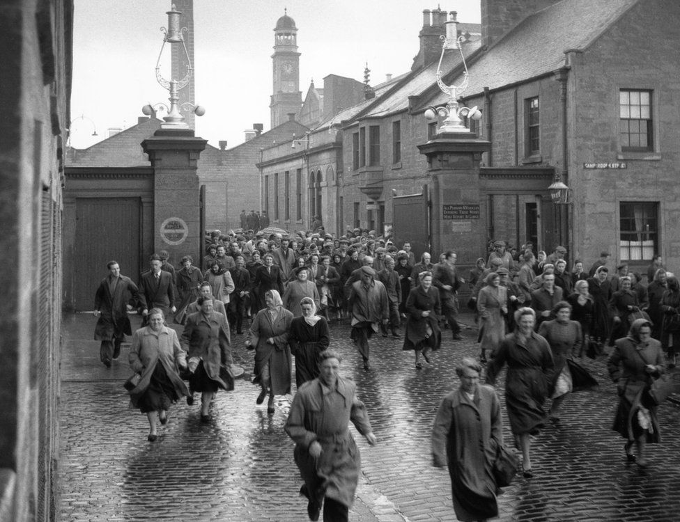 Workers leaving the mill in 1955