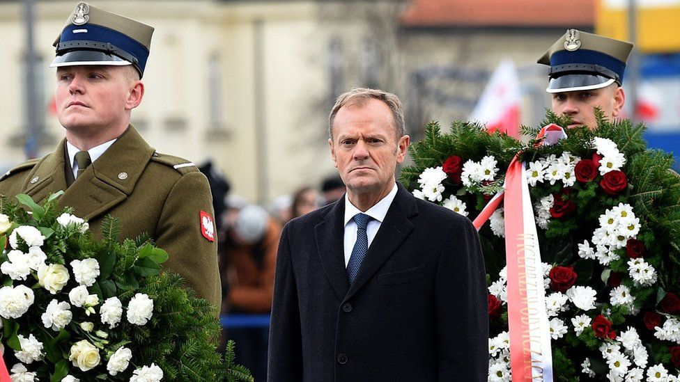 Former Polish Prime Minister and European Council President Donald Tusk lays a wreath at the Tomb of the Unknown Soldier, 11 November