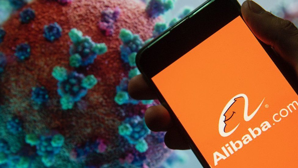 Alibaba on phone with coronavirus molecule in background