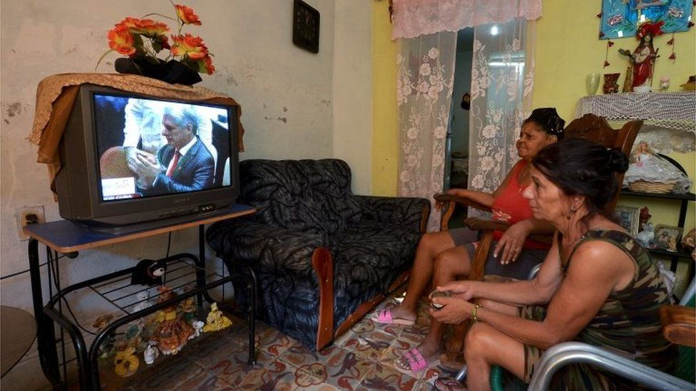 """Woman watch on TV in Havana Cuba""""s new President Miguel Diaz-Canel takes over from Raul Castro after he was formally named his successor by the National Assembly on April 19, 2018."""