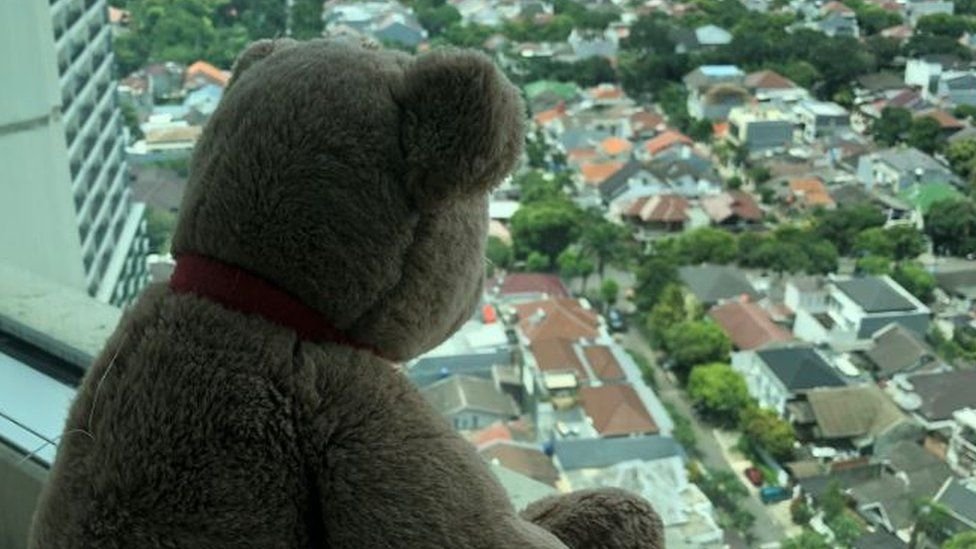 A teddy bear on a windowsill in Jakarta, Indonesia