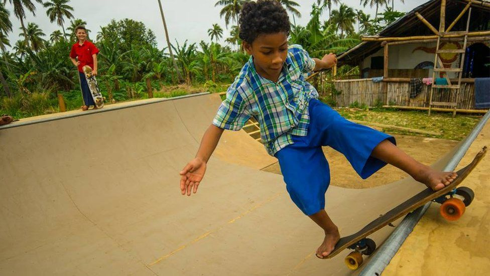 A Tongan boy skateboarding