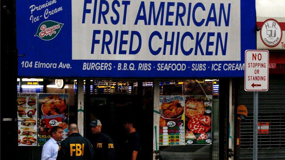 "FBI officers enter a restaurant called ""First American Fried Chicken"""