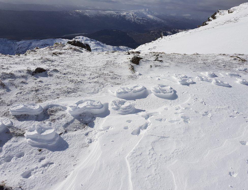 Raised footprints in the snow