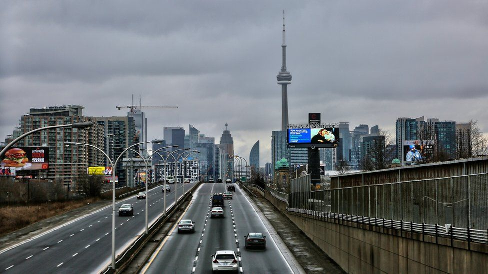 Traffic seen with the skyline of downtown Toronto, Ontario, Canada