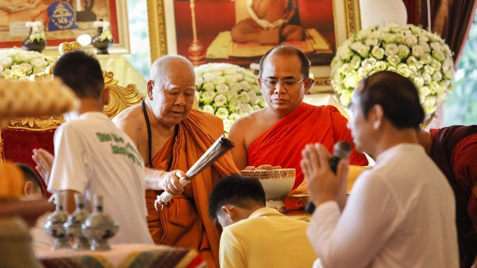 A Buddhist monk blesses some of the 12 Thai boys