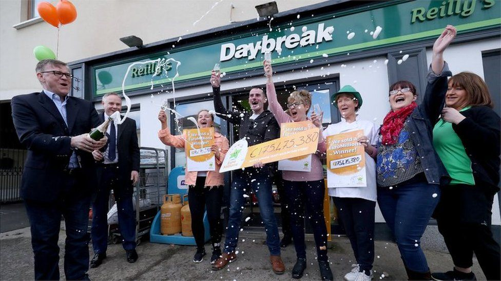 Staff at Reilly's Daybreak in Naul, where the winning ticket was sold, celebrate the family's big win
