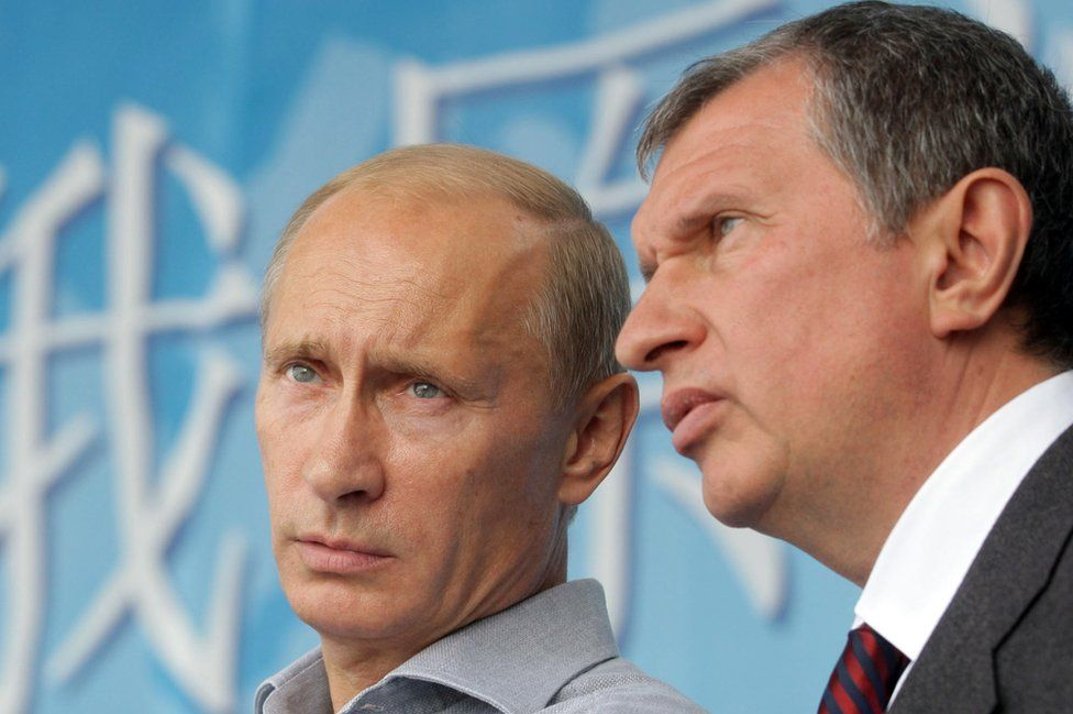 President Putin (L) counts Rosneft oil boss Igor Sechin (R) - 2010 file pic