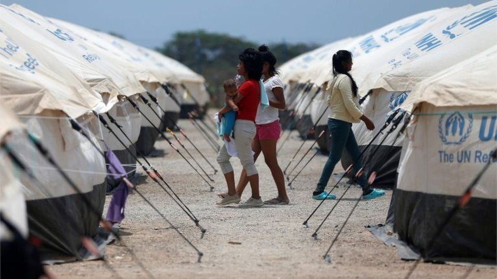 Venezuelan migrant women walk through a camp run by the UN refugee agency UNHCR in Maicao, Colombia May 7, 2019